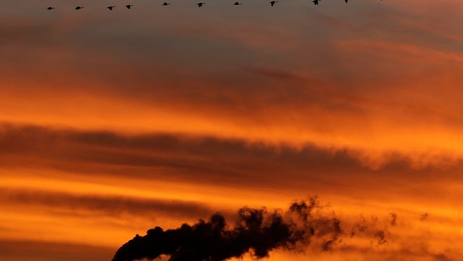 The Supreme Court ruled 5-4 Monday that the EPA cannot require greenhouse gas emission permits from new or modified industrial facilities as part of the Clean Air Act. Geese fly past the <137,2014/06/23,Smith/c Mark1>smokestacks at the<137> Jeffrey Energy Center coal-fired power plant<137,2014/06/23,Smith/c Mark1> as the suns sets<137> near Emmett, Kan.