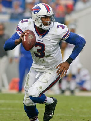 Buffalo Bills quarterback EJ Manuel (3) runs with the ball in the fourth quarter against the Jacksonville Jaguars at EverBank Field.
