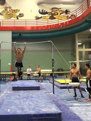 Iowa's men's gymnastics team practices inside the University