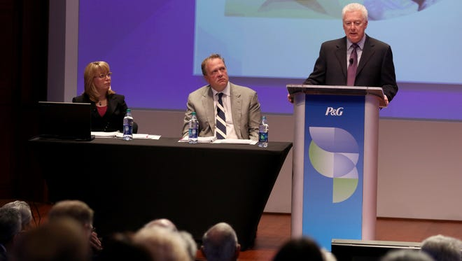 Procter & Gamble's Deborah Majoras, chief legal officer and secretary, left, and Jon Moeller chief financial officer, listen to P & G CEO A.J. Lafley speak during the annual shareholders meeting, Tuesday October 13, 2015.