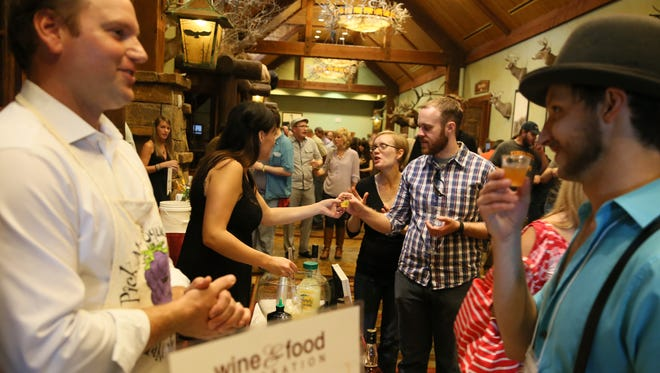 People line up at the annual Wine and Food Celebration, which raises money for children's programming at Ozarks Public Television
