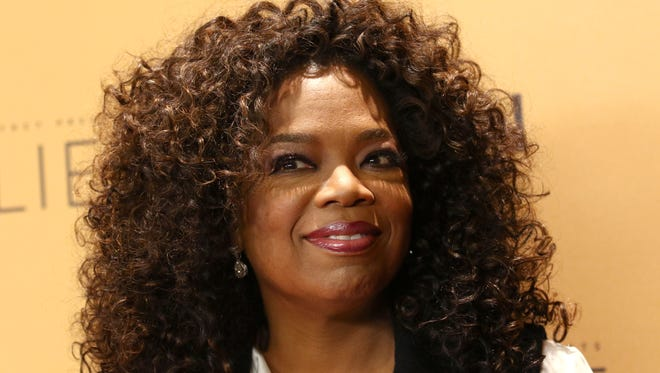 """File photo taken in 2015 shows Oprah Winfrey attending the premiere of the Oprah Winfrey Network's (OWN) documentary series """"Belief"""" in New York City."""