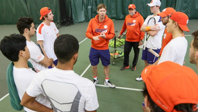 Clemson men's tennis head coach John Boetsch (middle) talks about the upcoming season during a break from practice.