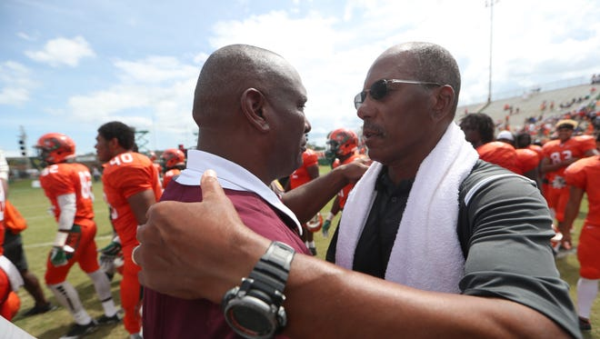 FAMU Head Coach Alex Wood hugs Texas Southern Head Coach Michael Haywood after the Rattlers 29-7 home opening win at Bragg Stadium on Saturday, Aug. 26, 2017.