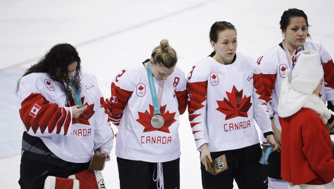 Jocelyne Larocque holds her silver medal after quickly taking it off her neck after Canada lost to the USA.