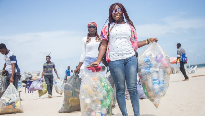 Volunteers in Nigeria participate in the 2017 International Coastal Cleanup day by cleaning beaches and waterways.