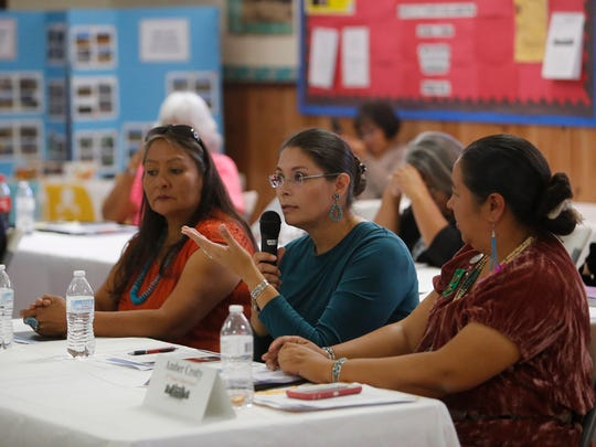 Sonlatsa Jim-Martin, COPE Project REACH policy analyst, center, talks about local food shed and food policies for the Navajo Nation during an Indian Affairs Committee meeting on Tuesday at the Tooh Haltsooí Chapter house in Sheep Springs.