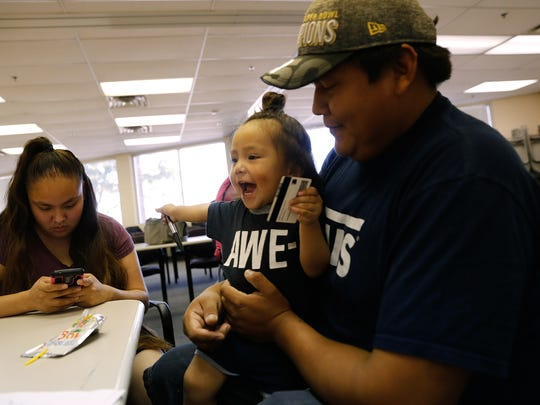 Shenika Sam, left, and Myron Ben, fill out paperwork for their son Mikaiya Ben for his birth certificate, Thursday, Sept. 22, 2016 at the Northern Navajo Agency Nataani Nez Complex in Shiprock.