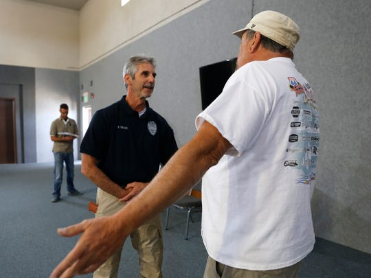 Farmington police Officer Ron Paquin talks with Public Safety Psychology Group role player John Morelock during a crisis intervention training class on June 3, 2016, at the Fraternal Order of the Police in Farmington.