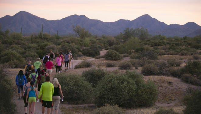Visitors take a full moon hike at McDowell Mountain Regional Park in Fountain Hills, Ariz. on July 2, 2015.