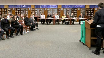 Jason Weimer makes his presentation on his business, All The Knowledge Today, to six investors and the 10 other teams making business presentations during a Greendale High School Young Entreprenuers Academy Investors Panel event on March 17. Weimer requested funds to expand an online photography and video training business that he created.