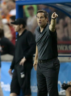 FC Cincinnati head coach John Harkes directs his team in the second half of the USL soccer match between FC Cincinnati and the Richmond Kickers at Nippert Stadium on the campus of the University of Cincinnati in Cincinnati on Saturday, June 4, 2016. FC Cincinnati and the Kickers played to a 1-1 tie after a Kickers goal in stoppage time.