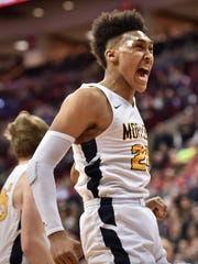 Moeller's Jeremiah Davenport can't contain his excitement after winning the Division I state boys basketball championship over No. 1-ranked Solon 83-65 March 24 in Columbus.