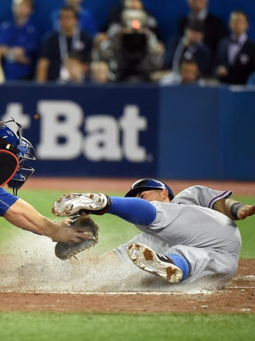 Rangers' Rougned Odor scores a run past the tag of