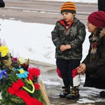 Korbyn Fair and his mother, Nasya, say a prayer Sunday in Colorado Springs at the memorial for the victims of Friday's deadly shooting at a Planned Parenthood clinic.