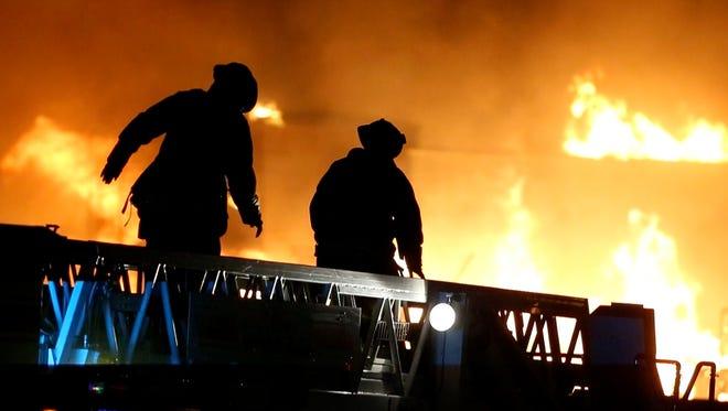 Fire crews fight a 5-alarm blaze in Gilbert on April 23, 2016.