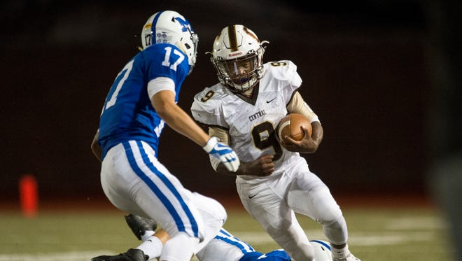Central's Tor'Jon Evans (9) faces off against Memorial's Miguel Turnbaugh (17) at Enlow Field in Evansville, Ind., on Friday, Sept. 29, 2017. Central won 35-7.