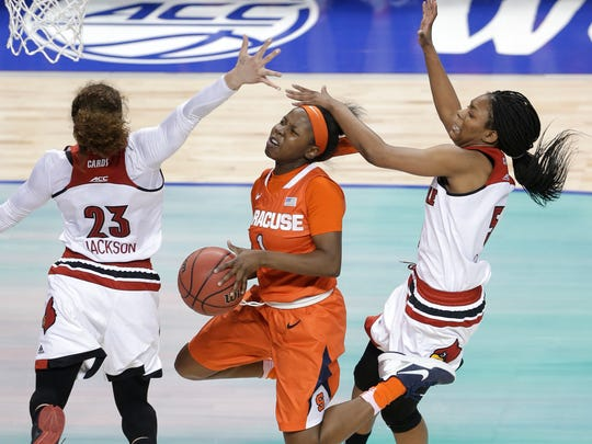 Syracuse's Alexis Peterson (center) is averaging 15.4 points and five assists per night.