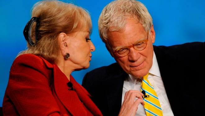 "Barbara Walters and guest David Letterman chat during a commercial break on the first show of the 14th season of ""The View."""