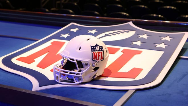 A general view of a helmet and NFL shield logo before the start of the 2014 NFL Draft