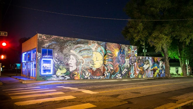A store illuminates the streets of Colorado Springs.