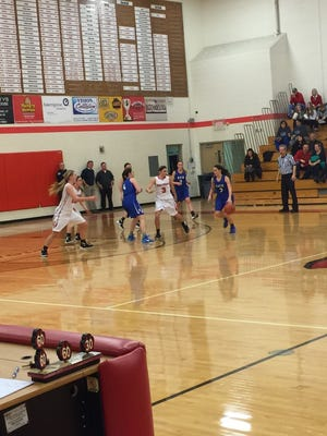 The Bath girls basketball team topped Laingsburg Friday night to make the CMAC a three-way race.