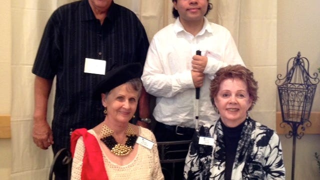 Front row: Fundraising chair Marie Hoesman and Beverly Adair. Back row: Honoree Dan Reynolds and author John Robbins