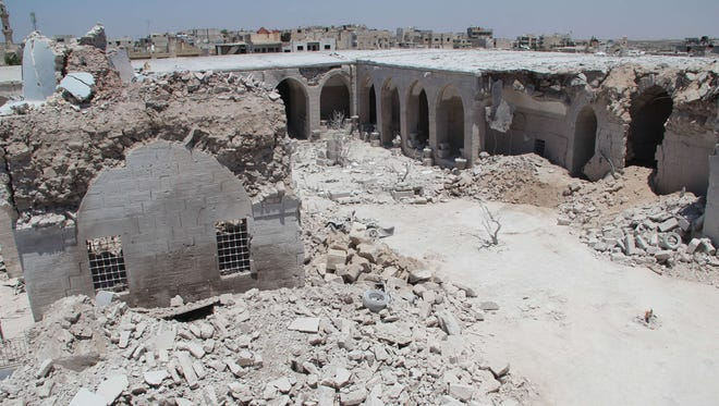 The Ottoman era Murad Pasha caravanserai (or Khan Murad Pasha), which dates back to 1565 and serves as a museum with a collection of ancient artifacts and mosaics, is partially destroyed in the opposition-controlled Syrian city of Maaret al-Numan in the Idlib province on June 16, 2015, following reported airstrikes by Syrian government forces.
