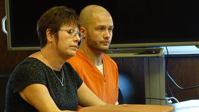 Brandon Bullard, right, with attorney Colleen Robinson was sentenced to six years prison.