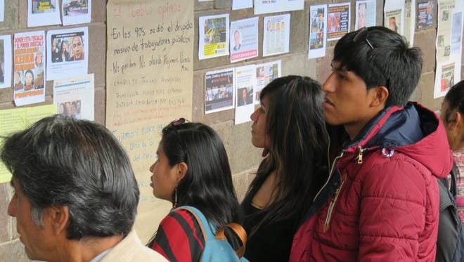 Cusco residents scanned fresh political posters each day to learn the latest about the Peruvian election.