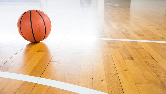 Basketball ball over floor in the gym.