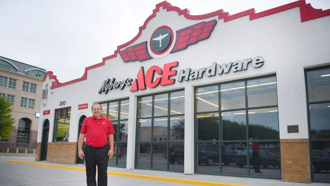 Owner Kevin Nyberg stands outside of Nyberg's Ace Hardware store Thursday morning. Nyberg is prepping the store for opening day, Friday, Aug. 4.