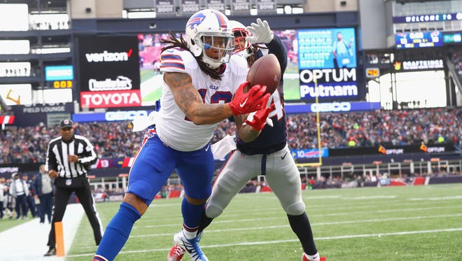 Kelvin Benjamin of the Buffalo Bills tries to catch a pass as he is defended by Stephon Gilmore #24 of the New England Patriots during the quarter of a game against the Buffalo Bills at Gillette Stadium on December 24, 2017 in Foxboro, Massachusetts. The touchdown was reversed after an official review.