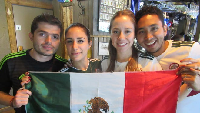 Mexican National Team fans watching the match against Germany.