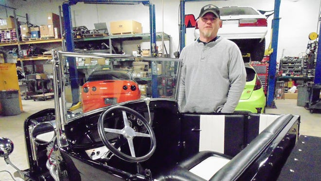 Chris Shevlin of Farmington Hills bought his 1928 Model A Ford Roadster Pickup, took it apart and customized it.
