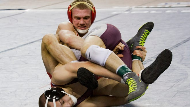 Edison's Robert Cleary works to gain control during his 132 lbs bout against Phillipsburg's Brandon Paetzell.  Quarterfinal Round at  NJSIAA State Wrestling Tournament in Atlantic City, NJ on March 5, 2016