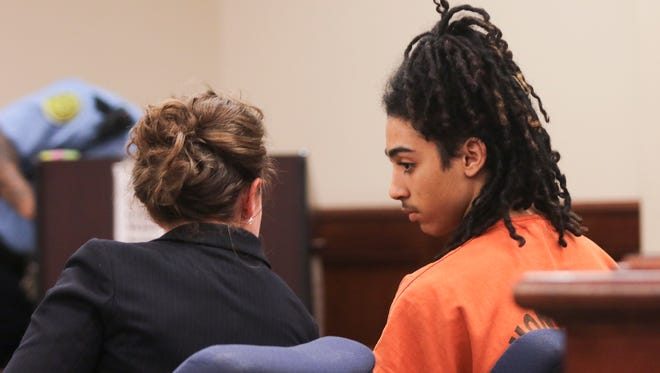 Clinton Hunter III listens to his attorney, Adrienne Fry, during his preliminary hearing in General Sessions Court.