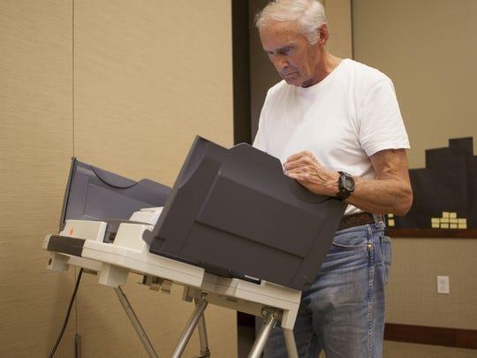 Washington City citizen Dee Whittaker votes at the Washington City Library Tuesday, Aug. 11, 2015.