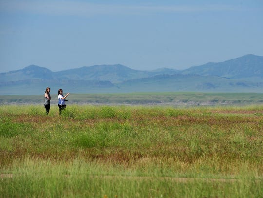 Visitors take in the views at First Peoples Buffalo