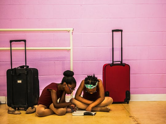 """May 25, 2017 - Kayla Dowdy, 10, left, and Jamirra Rhodes, 9, read the book """"Hidden Figures,"""" by Margot Lee Shetterly during rehearsal for the dance performance of """"Annie"""" at the Ballet On Wheels Dance School & Company in Cooper Young on Thursday. Performances will be held on Saturday, June 3, at 7 p.m. and Sunday, June 4, at 2:30 p.m. at the Halloran Centre for Performing Arts and Education at 225 S. Main St. Tickets are available at www.ticketmaster.com."""