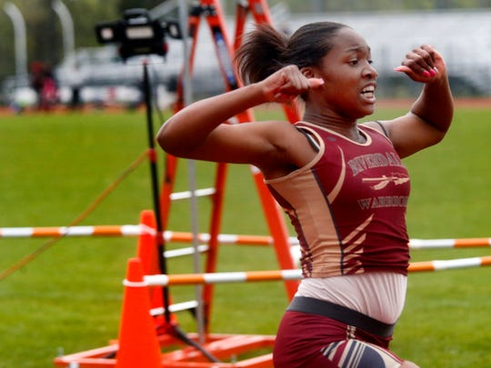 Riverdale's Ar'Nazsia Johnson crosses the finish line  in the Girls 100 Meter Dash at the Rutherford County Girls Track and Field Championship at Stewarts Creek on Tuesday April 24, 2018.