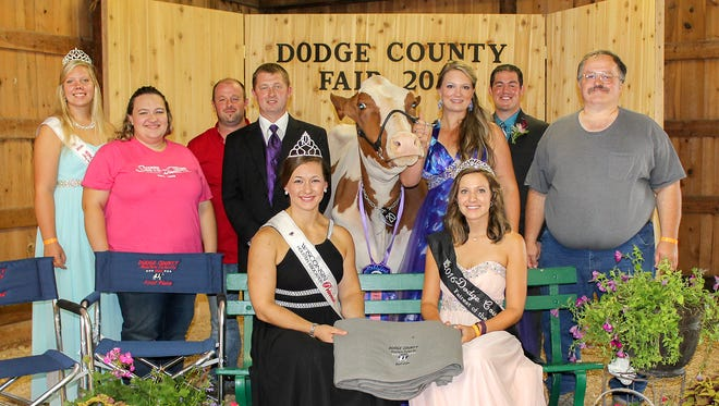 Rynearson Rainy Razzy-Red (center) won first place, best bred and owned, and best udder at the Dodge County Holstein Futurity event. Rynearson Rainy Razzy-Red, owned by Don Rynearson, led by Kate Smith of Smith Crest Holsteins, Watertown. Front row (from left) Kati Kindschuh, Wisconsin Holstein Princess, and Anna Boschert, Dodge County Fairest of the Fair. Back row (from left) Danielle Warmka, Wisconsin Red and White Dairy Cattle Association Princess; Holly, Matt, and Travis Smith; Razzy with Kate Smith; Judge Jeff Brantmeier, and owner Don Rynearson.