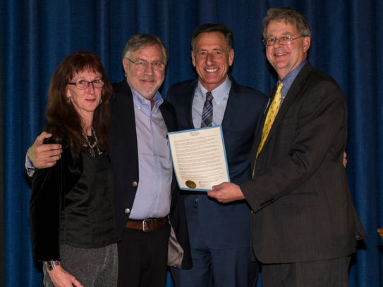 Chard deNiord (second from left), new poet laureate