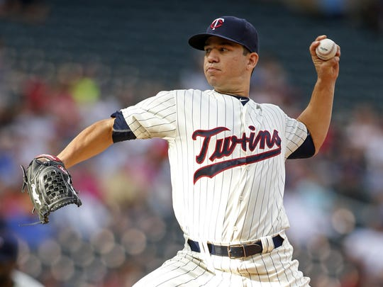Minnesota Twins starting pitcher Tommy Milone (33) pitches to the Chicago White Sox in the first inning Saturday at Target Field in Minneapolis.