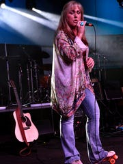 Twyla Foreman sings with Soul Free Revival during the 9th annual Garage Band Woodstock at the Abilene Convention Center.