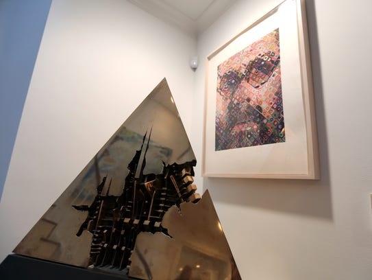 Pieces by Palmadero and Chuck Close are part of the