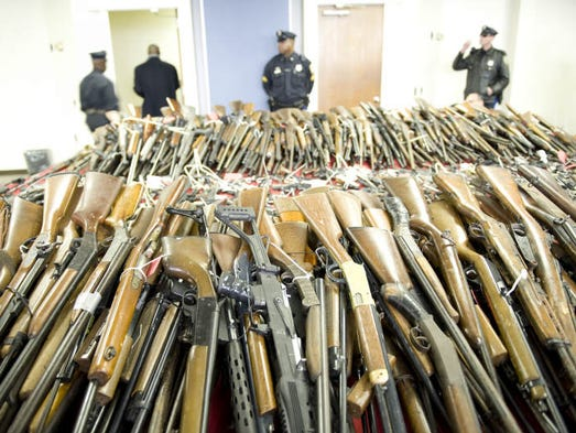 Guns that were surrendered as part of the gun buyback program are displayed at the Camden Police Headquarters. Tuesday, December 18, 2012.