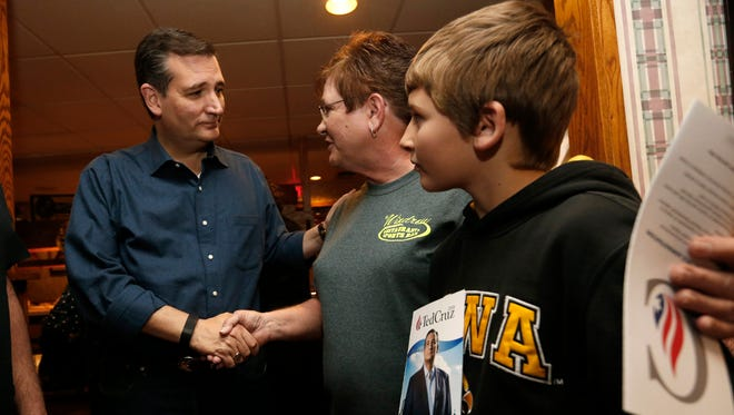 Republican presidential candidate Ted Cruz greets restaurant owner Janet Hayes and her grandson, Damon, 12, Saturday, Nov. 28, 2015, during a campaign stop at the Windrow Restaurant in Creston, Iowa.