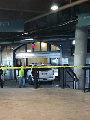 A police car crashed into the waiting area of the ferry slip at the Hoboken Terminal.