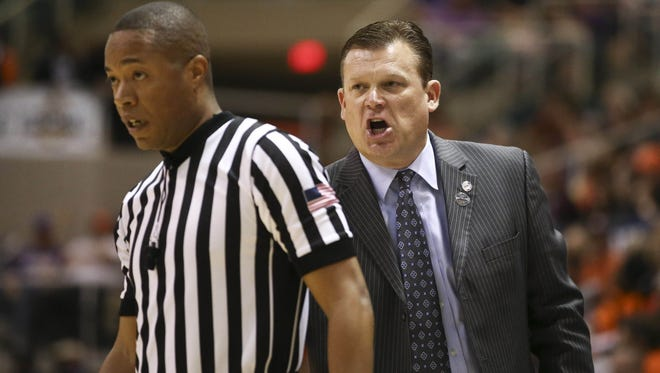 Mar 15, 2014; Katy, TX, USA; Stephen F. Austin Lumberjacks head coach Brad Underwood yells at an official in the championship game for the Southland Conference college basketball tournament against Sam Houston State Bearkats at Merrell Center. Mandatory Credit: Jim Cowsert-USA TODAY Sports